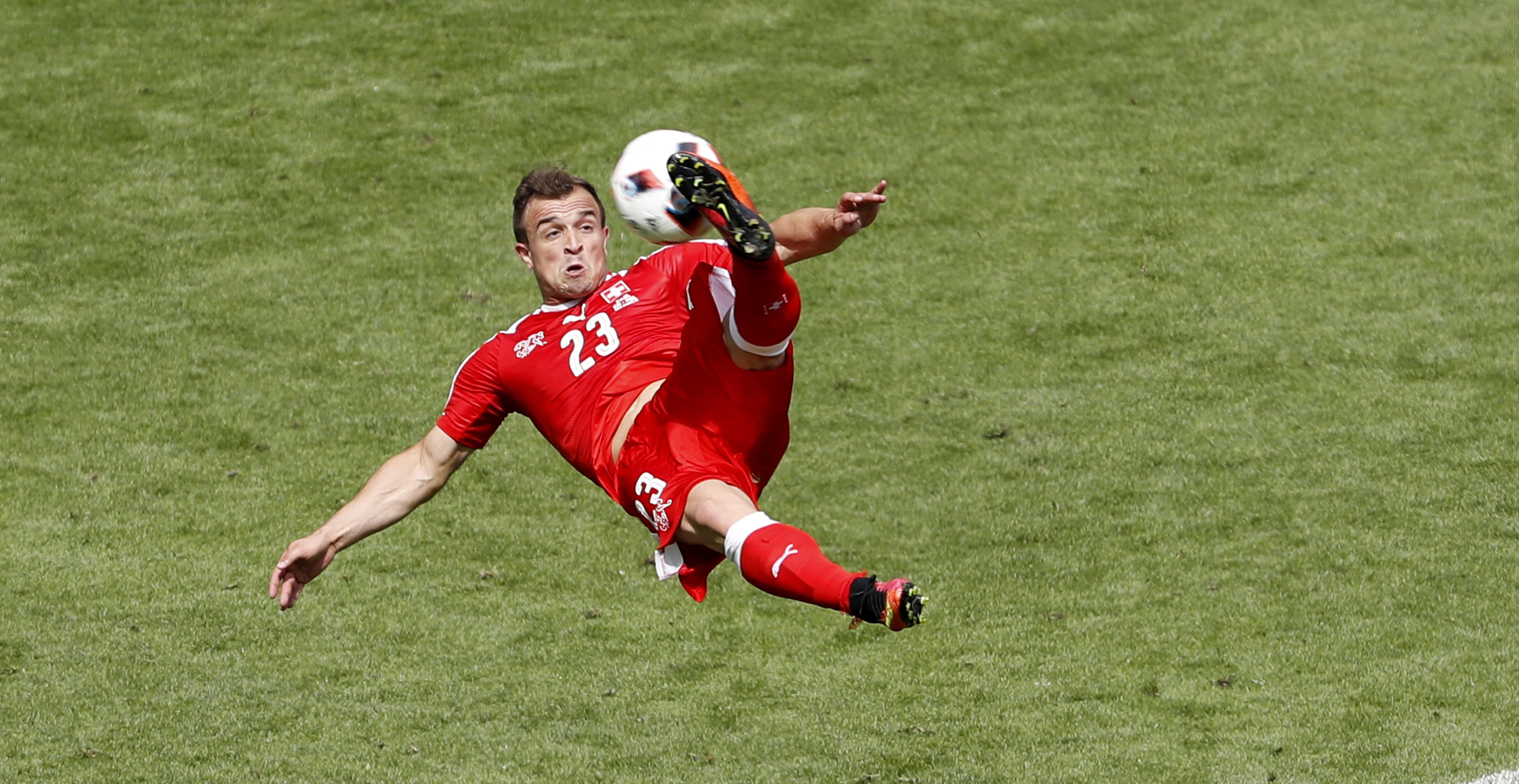 Euro 2016: Poland sink Swiss on penalties after brilliant Shaqiri goal