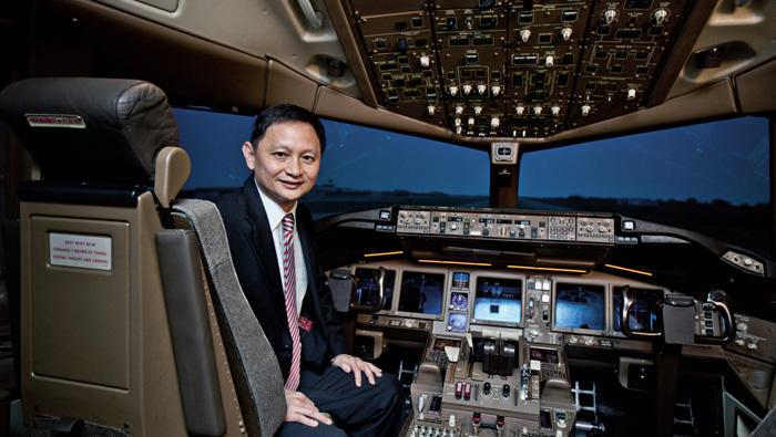 Singapore Air warns of tough days even as profit triples