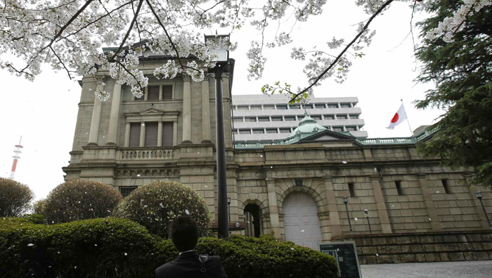Japan expands stimulus, plans policy review