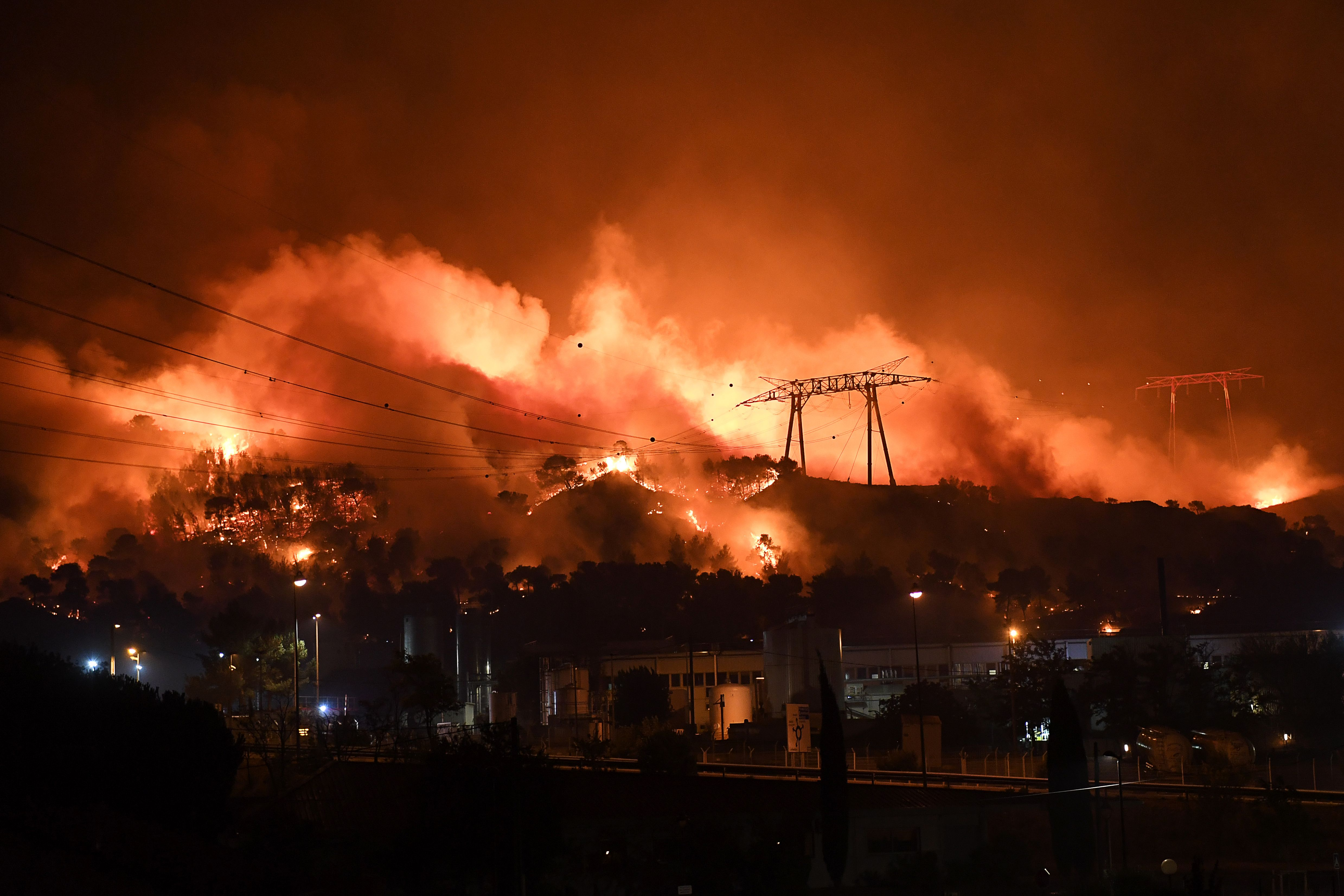 Wild fires spread in southern France, four firemen injured