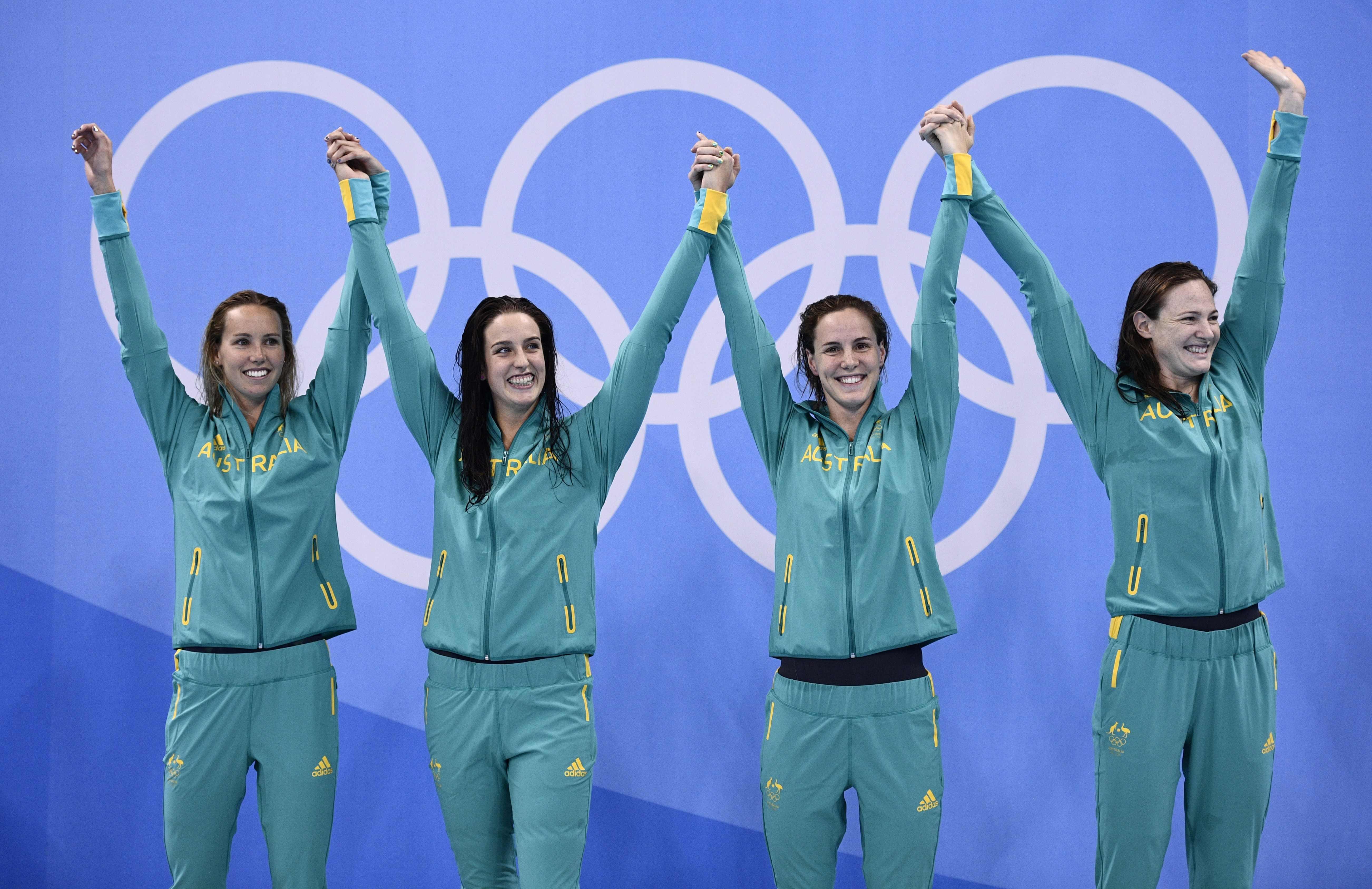 Swimming: Golden start for Australia on day of records