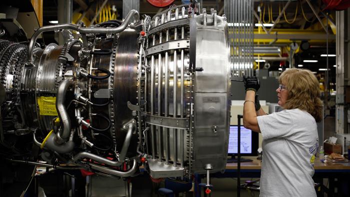GE cuts outlook as sluggish economy crimps industrial demand