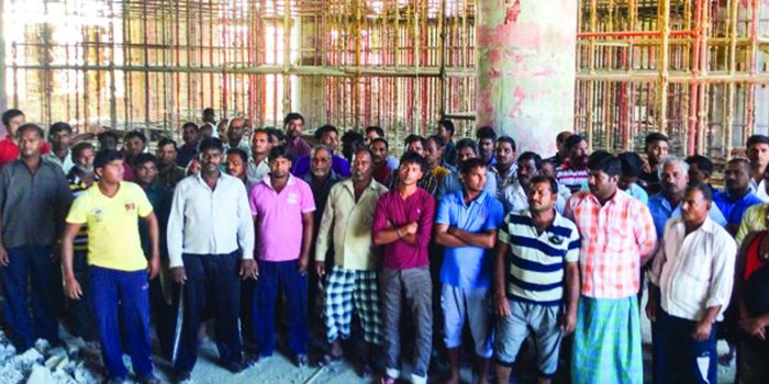 Workers back on duty after part of pending wages paid in Oman