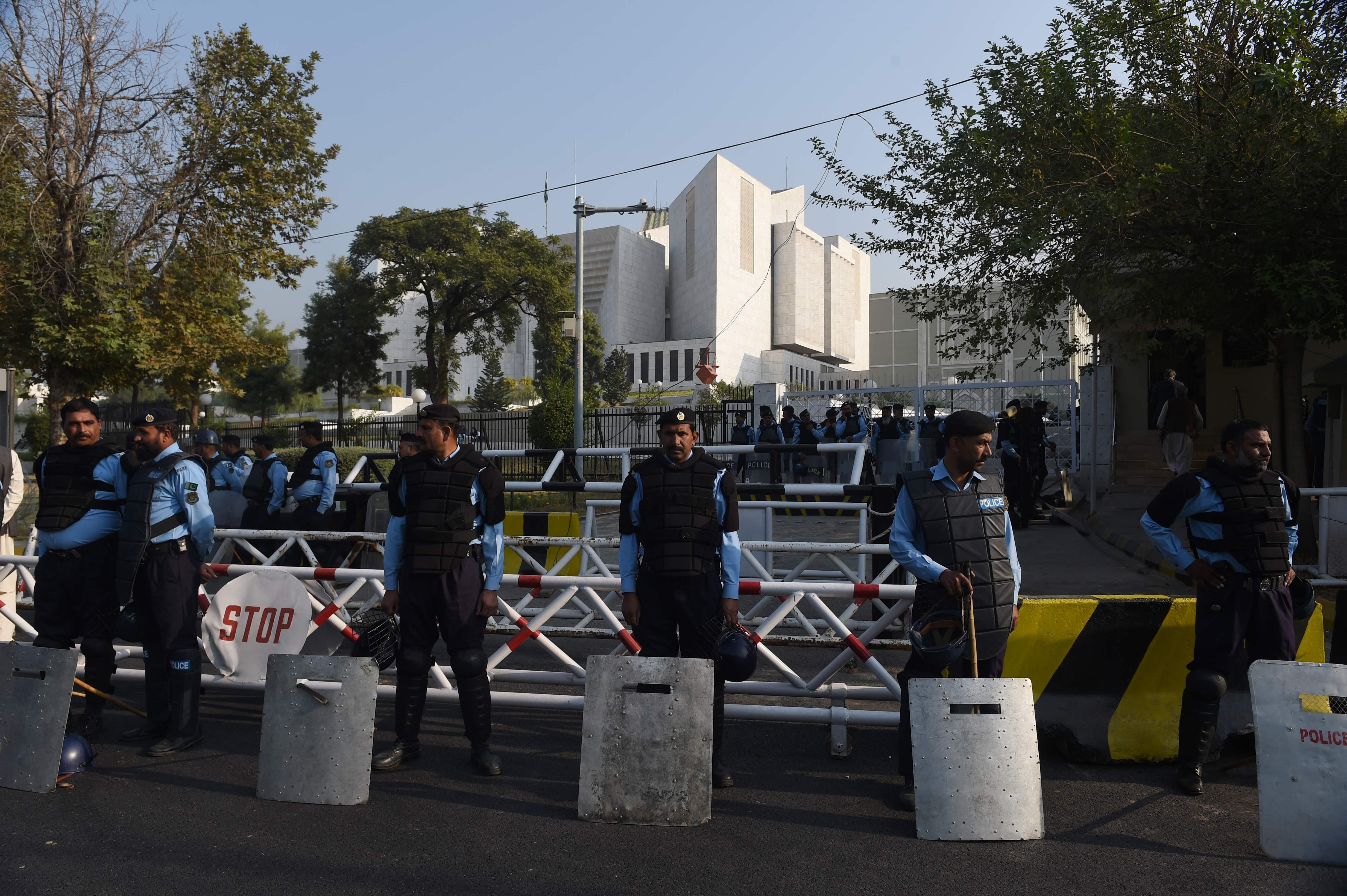 Pakistan's Imran Khan backs off from threat to shut down capital