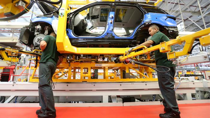Tata Motors swings to profit amid boardroom battle