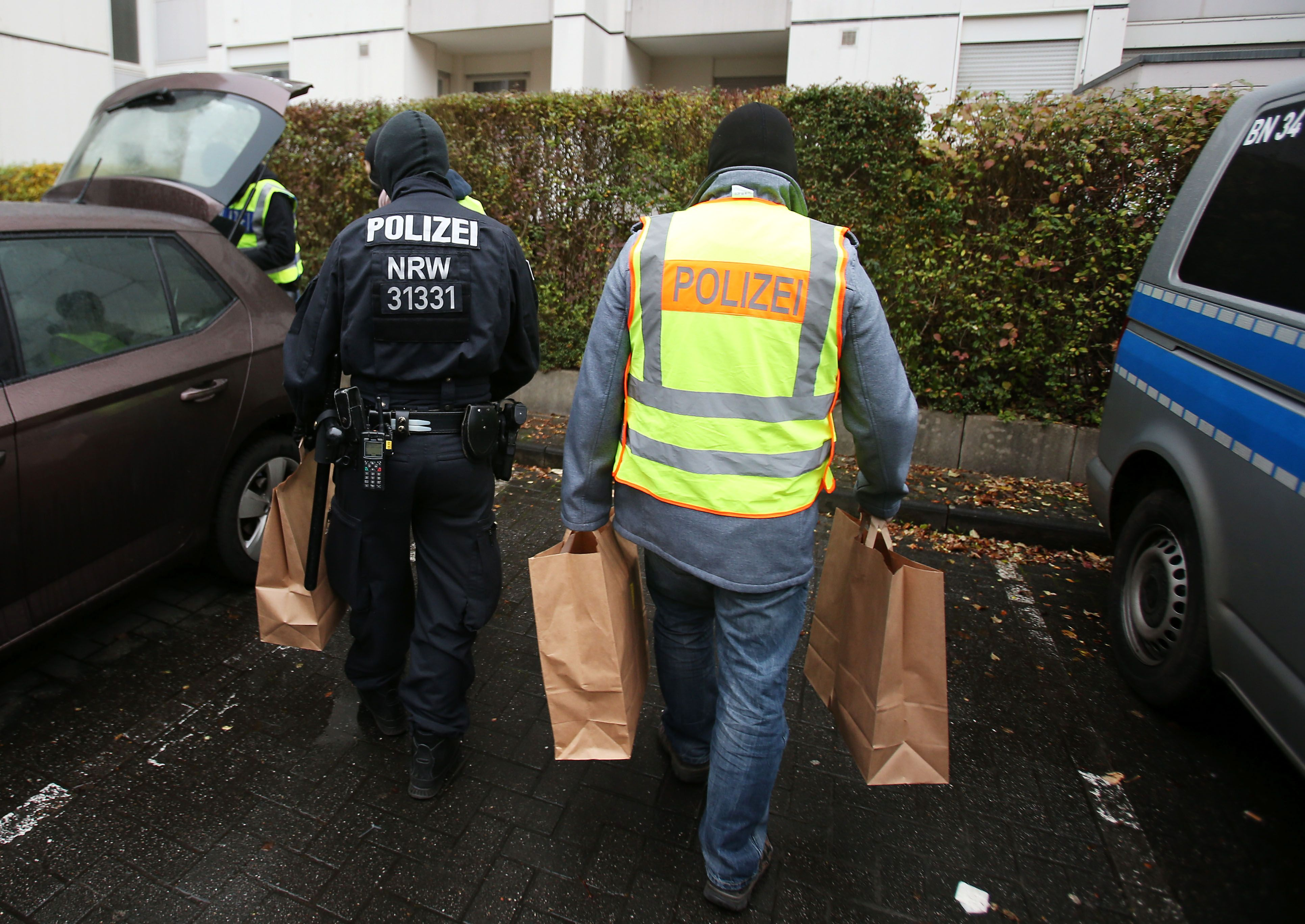 German authorities raid mosques and flats, ban extremist group