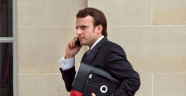 Polls, Macron campaign throw French presidential election open