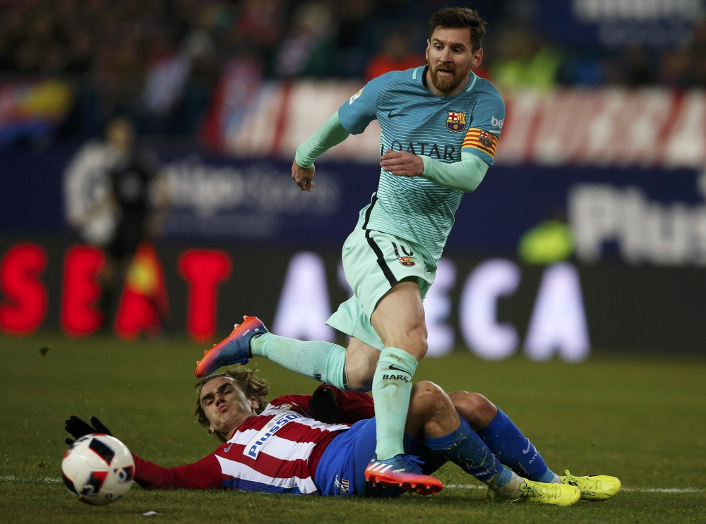 Football: Messi and Suarez give Barcelona slender lead over Atletico Madrid
