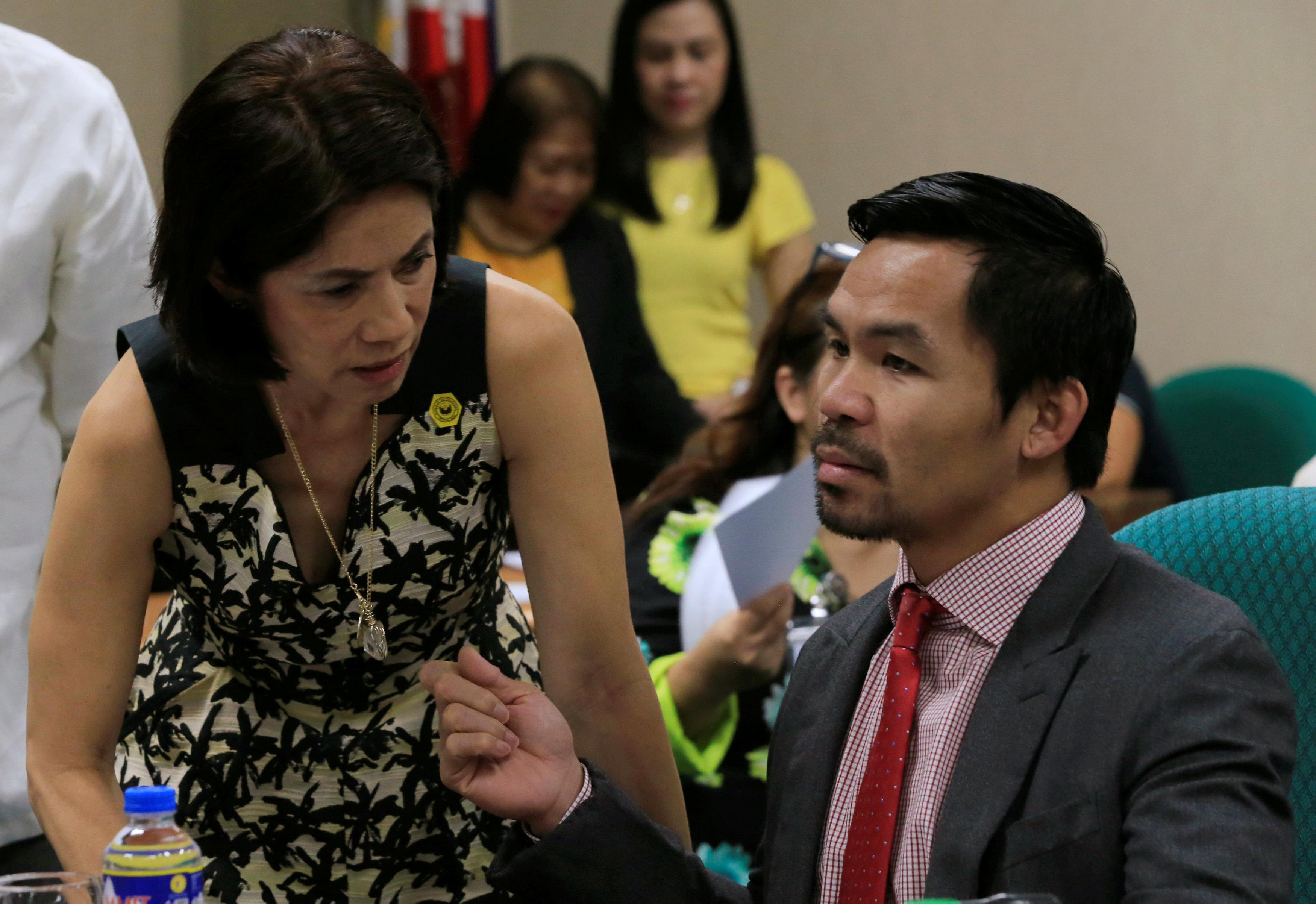 Philippine lawmakers postpone vote on embattled minister