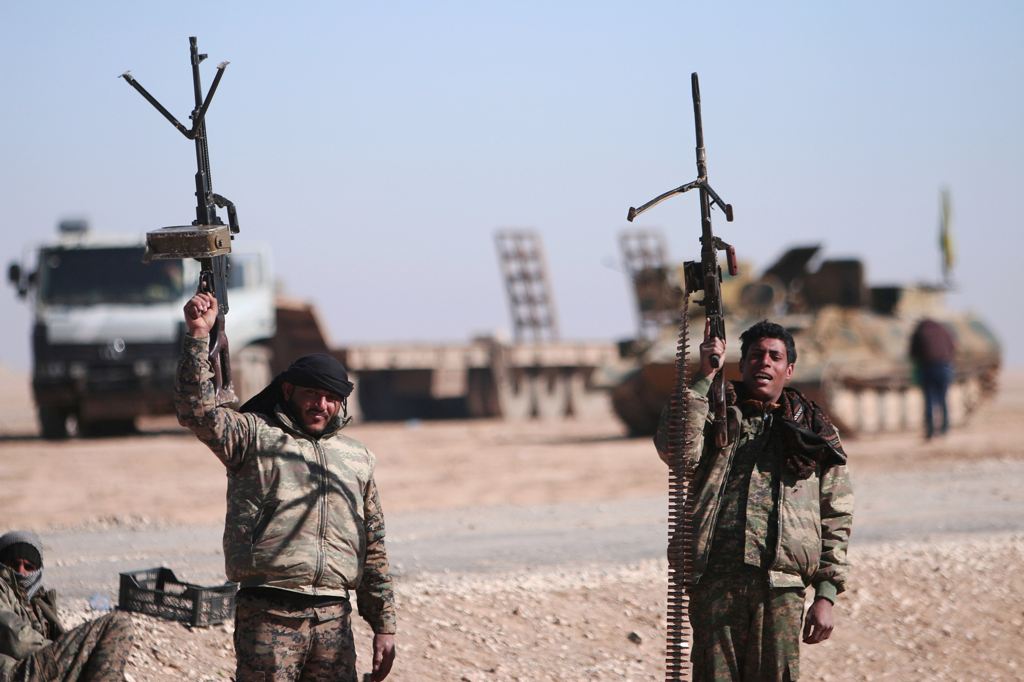 U.S.-backed Syrian force cuts last road out of IS stronghold