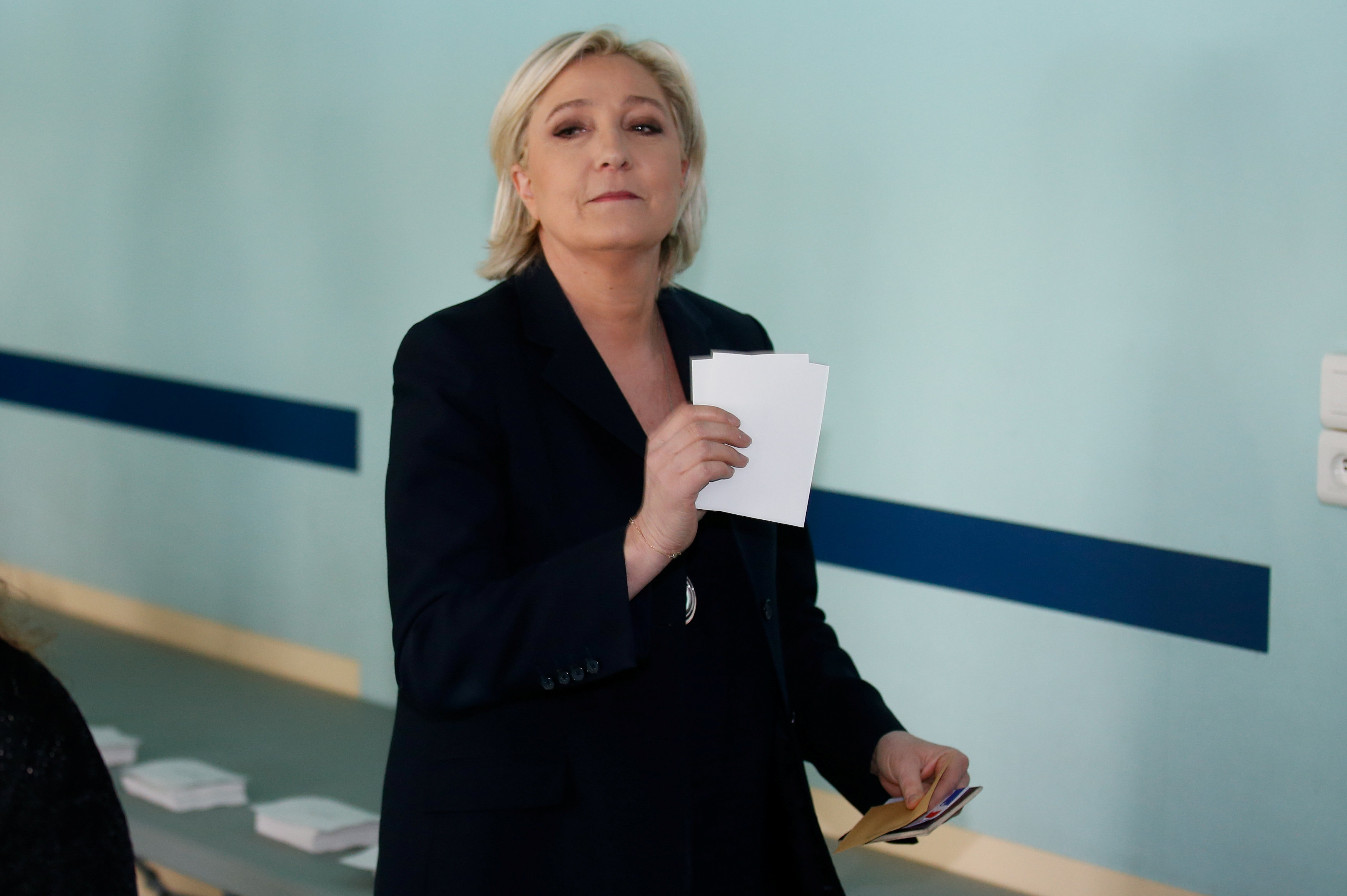 Projections say Macron, Le Pen go through to runoff in French vote