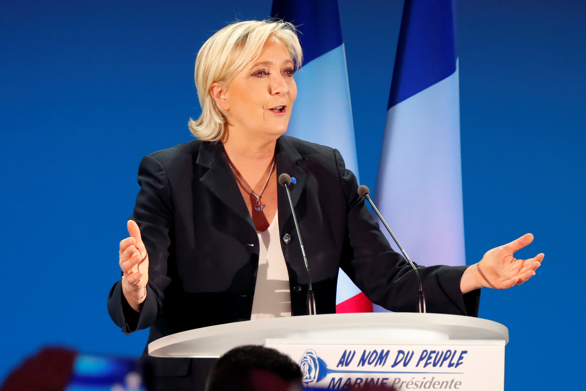 French election: Le Pen's camp turns fire on Macron
