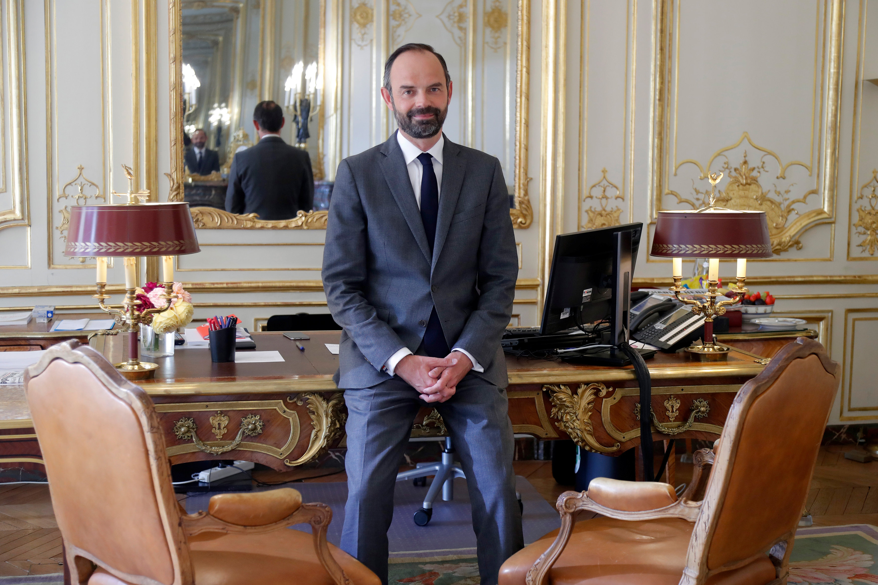 Macron's new-look government stretches across French political spectrum