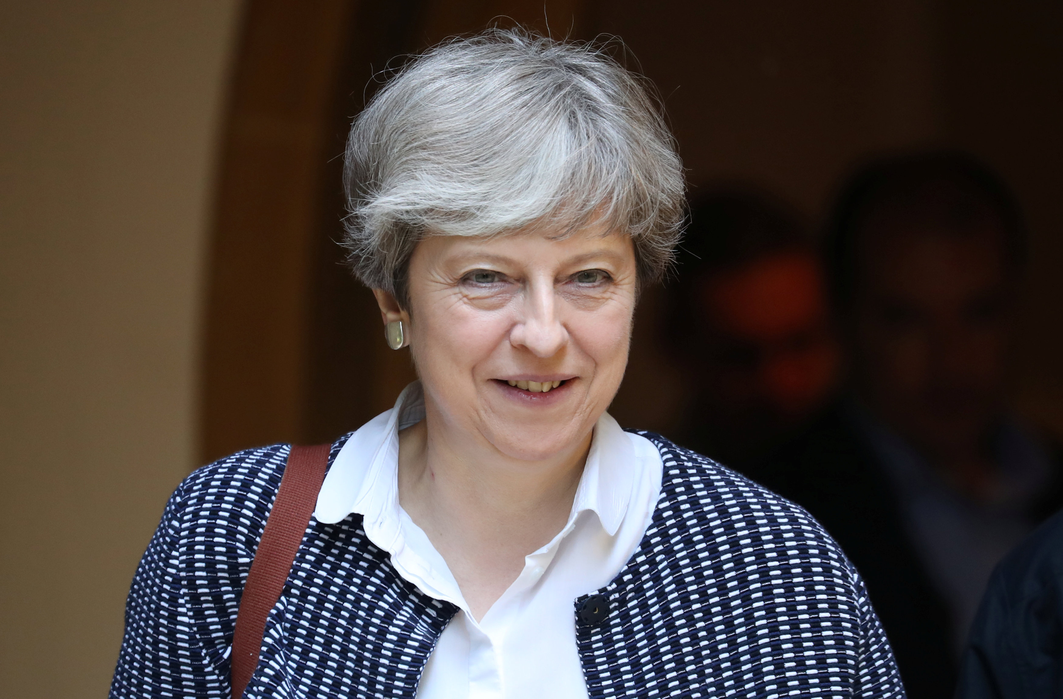 After fire, May's government vows to protect Britons