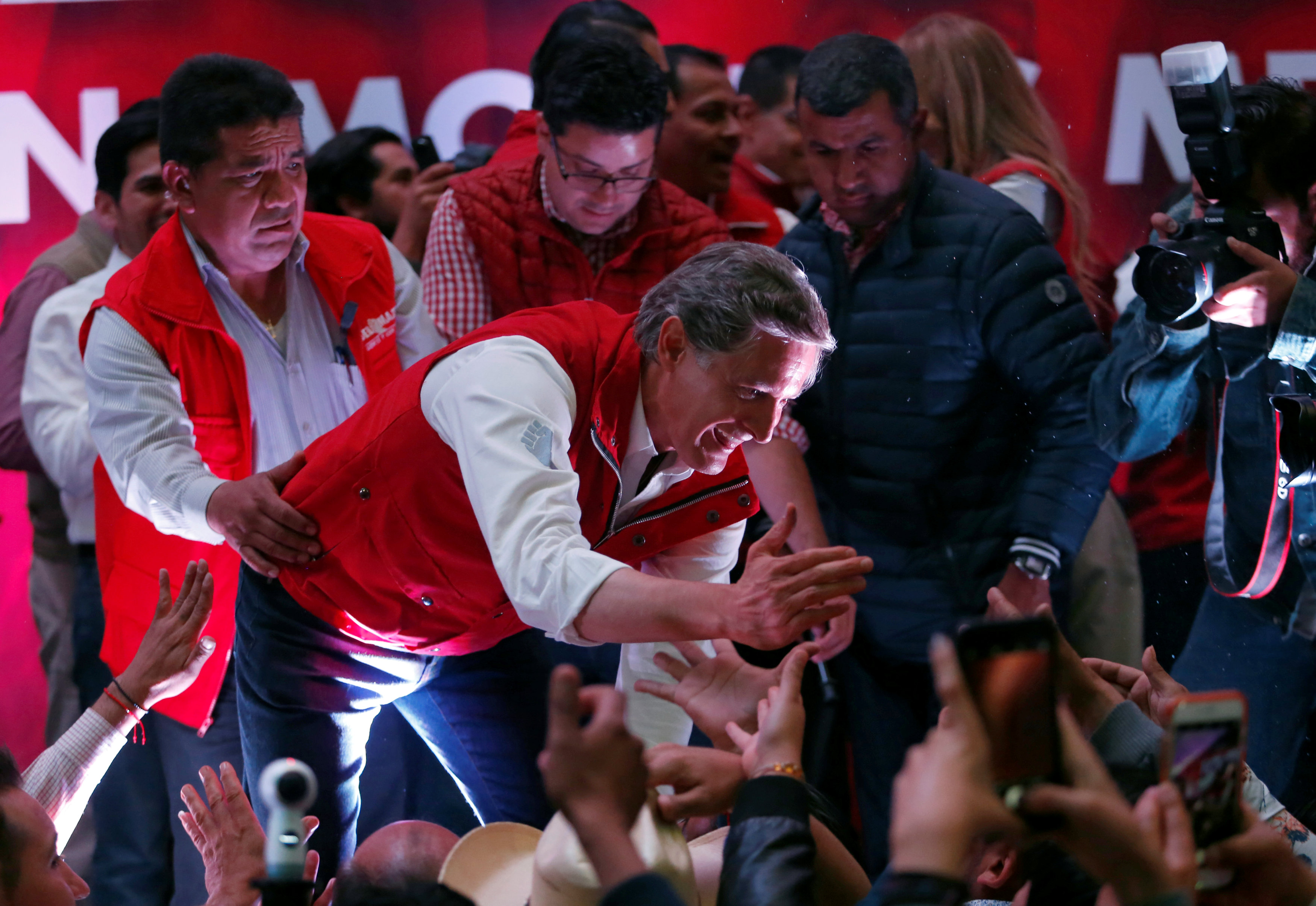 Mexico's ruling party narrowly fends off leftist in major state election