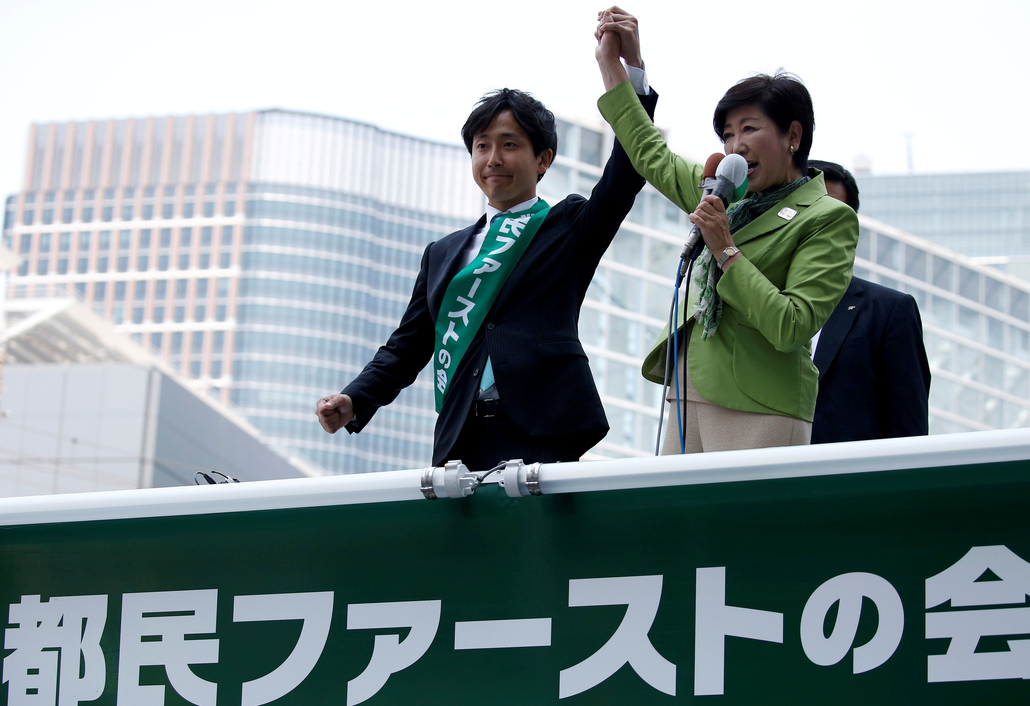 Japan prime minister's party suffers historic defeat in Tokyo poll