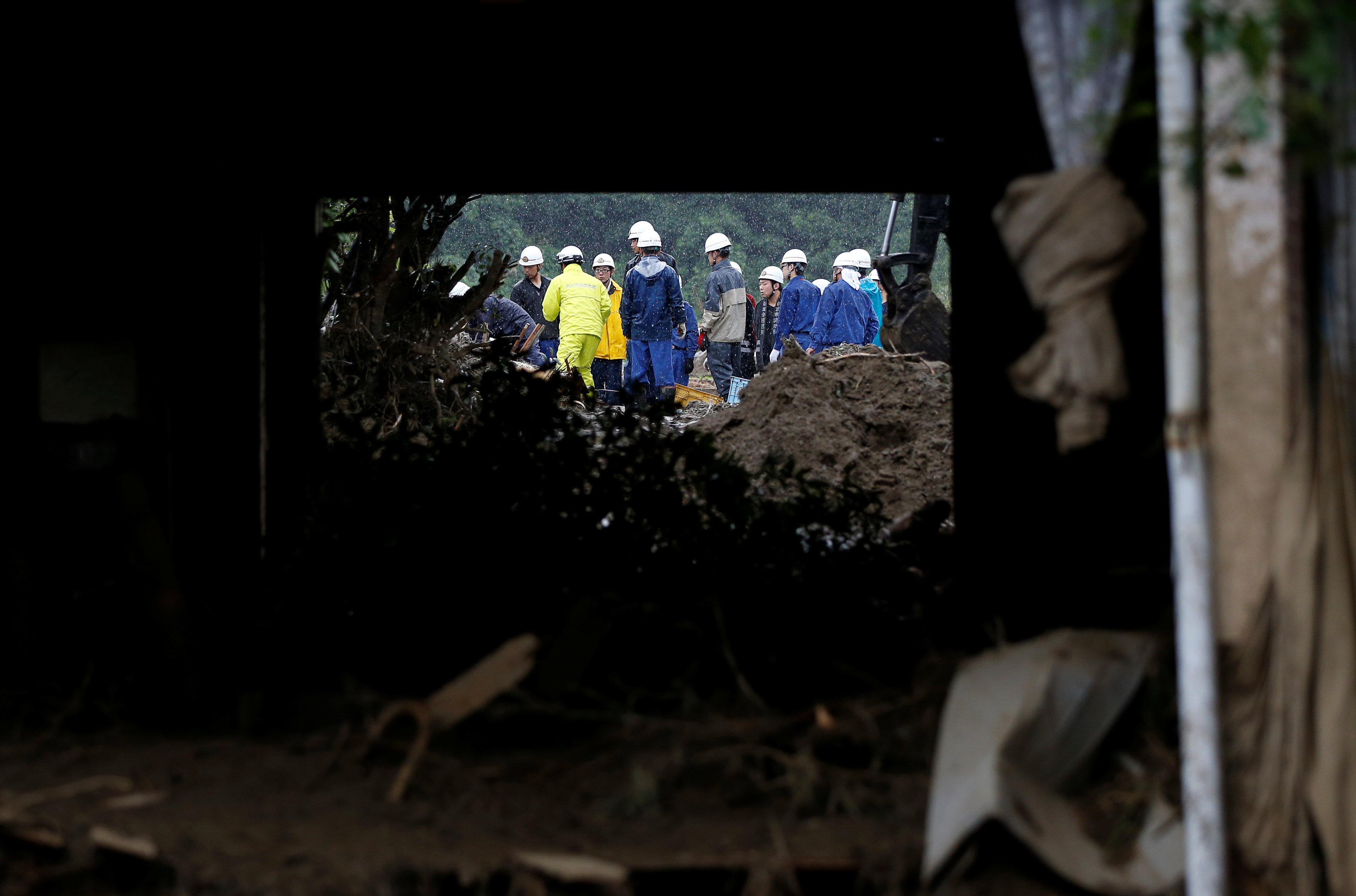 Japan rescuers continue search as more rain forecast, at least 18 dead