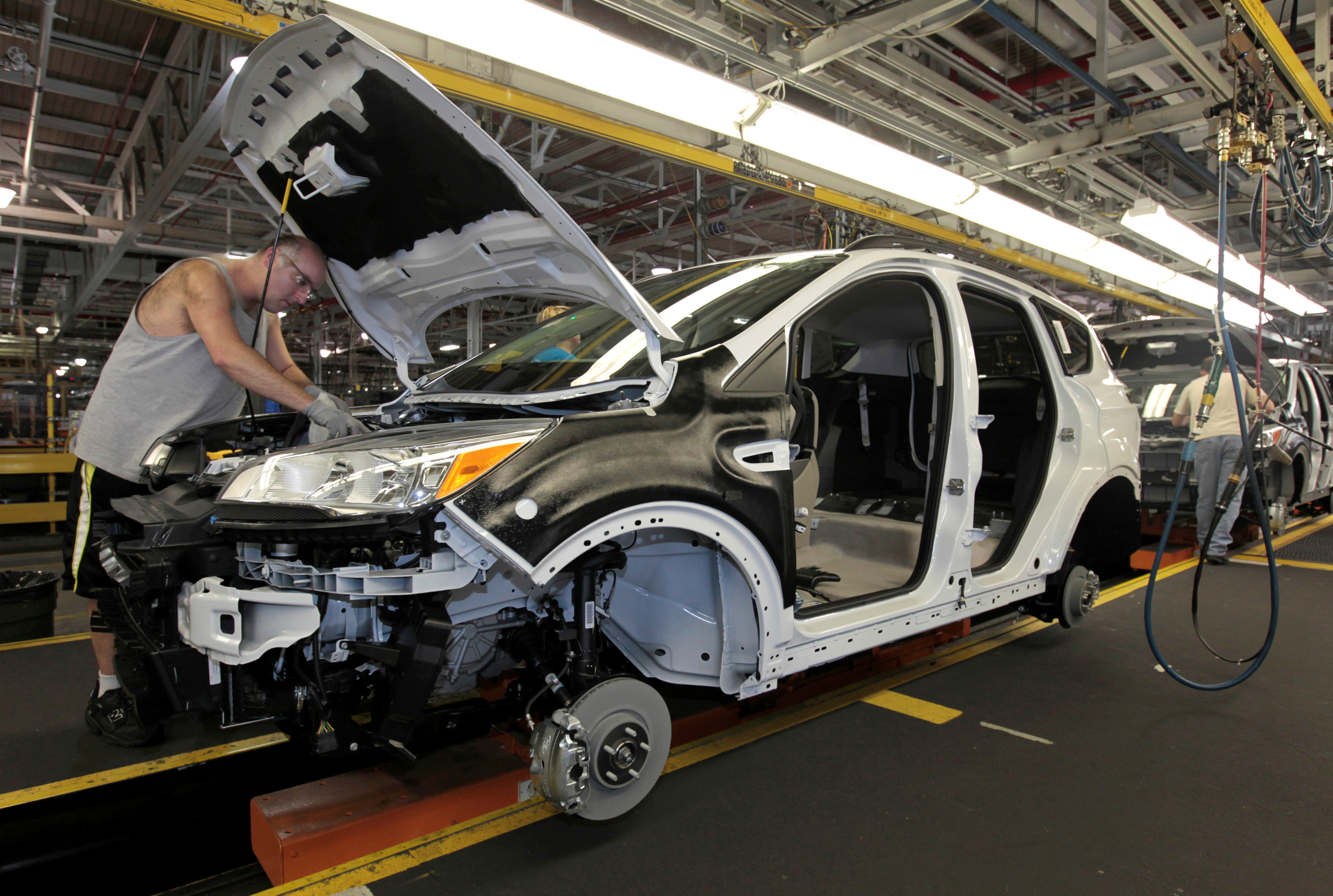 US factory activity slows; consumer spending nudges up