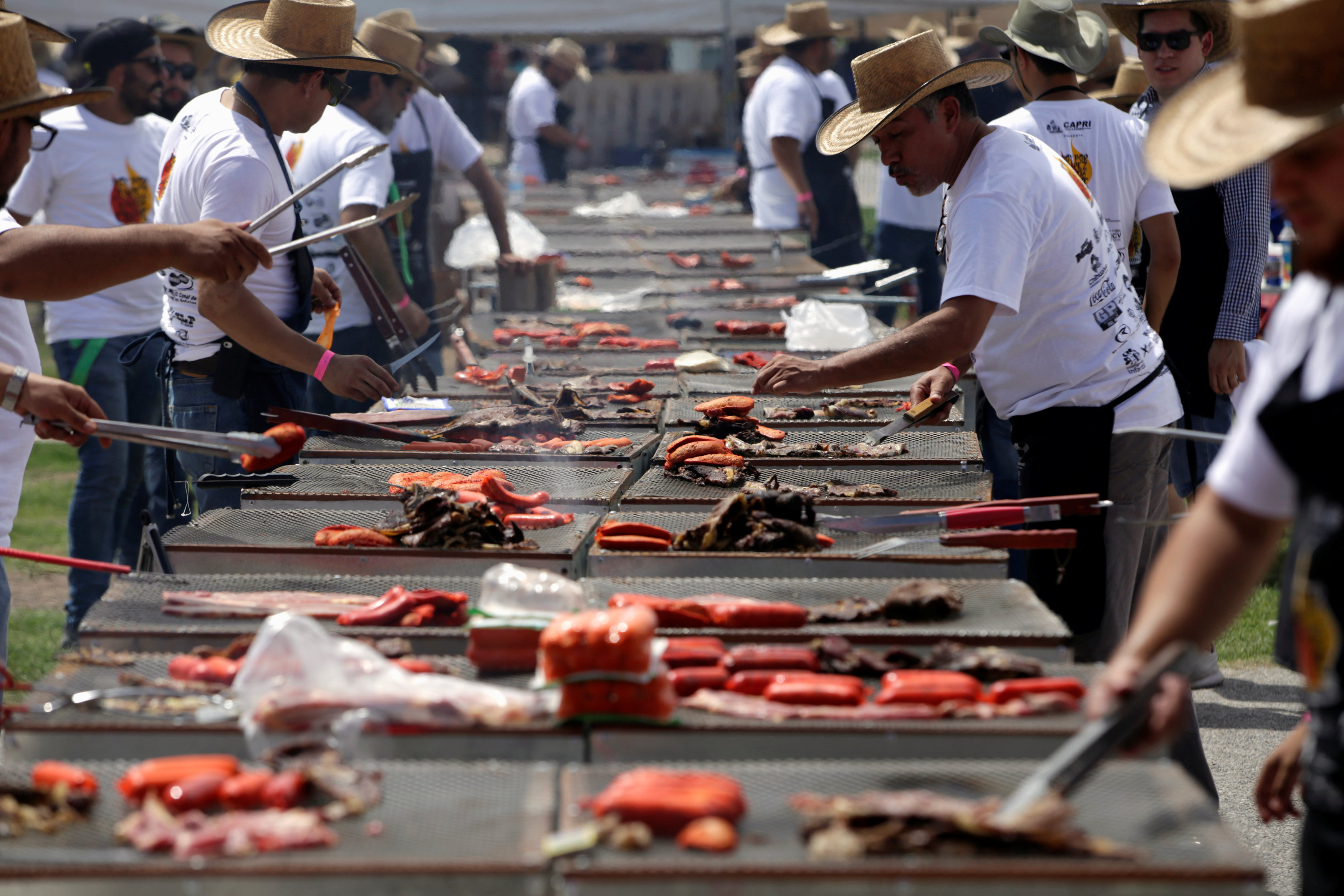 In pictures: More than 350 participants bid to break Guinness record of grilling meat