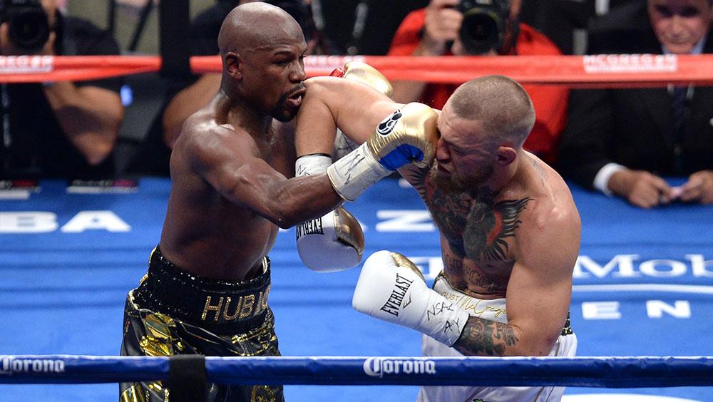 Boxing: Mayweather earns TKO win over McGregor