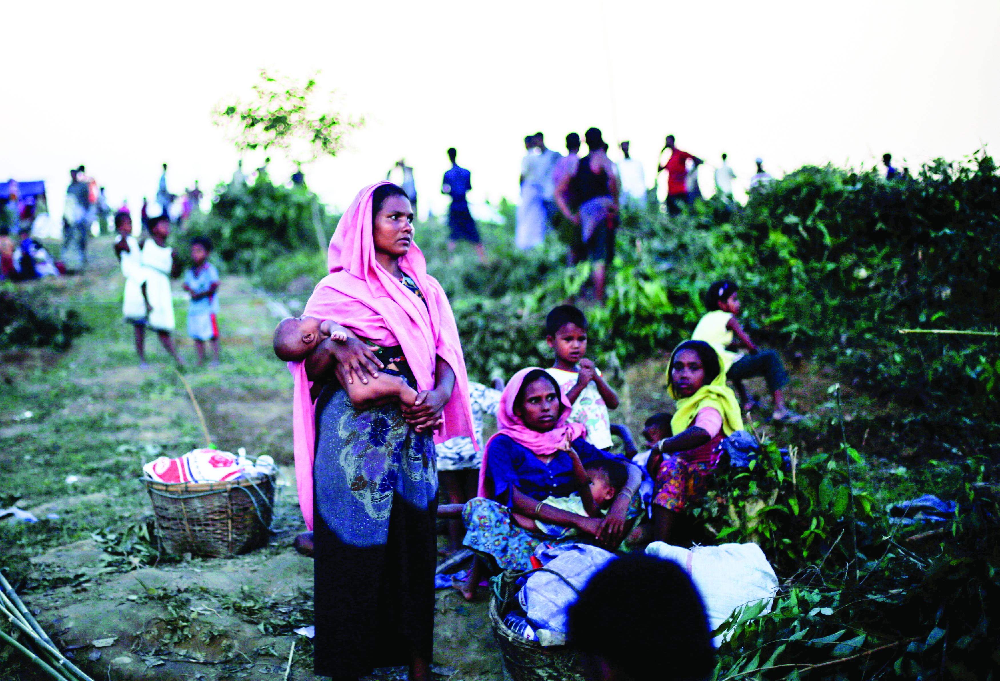 Bangladesh warns Myanmar over border amid Rohingya refugee crisis