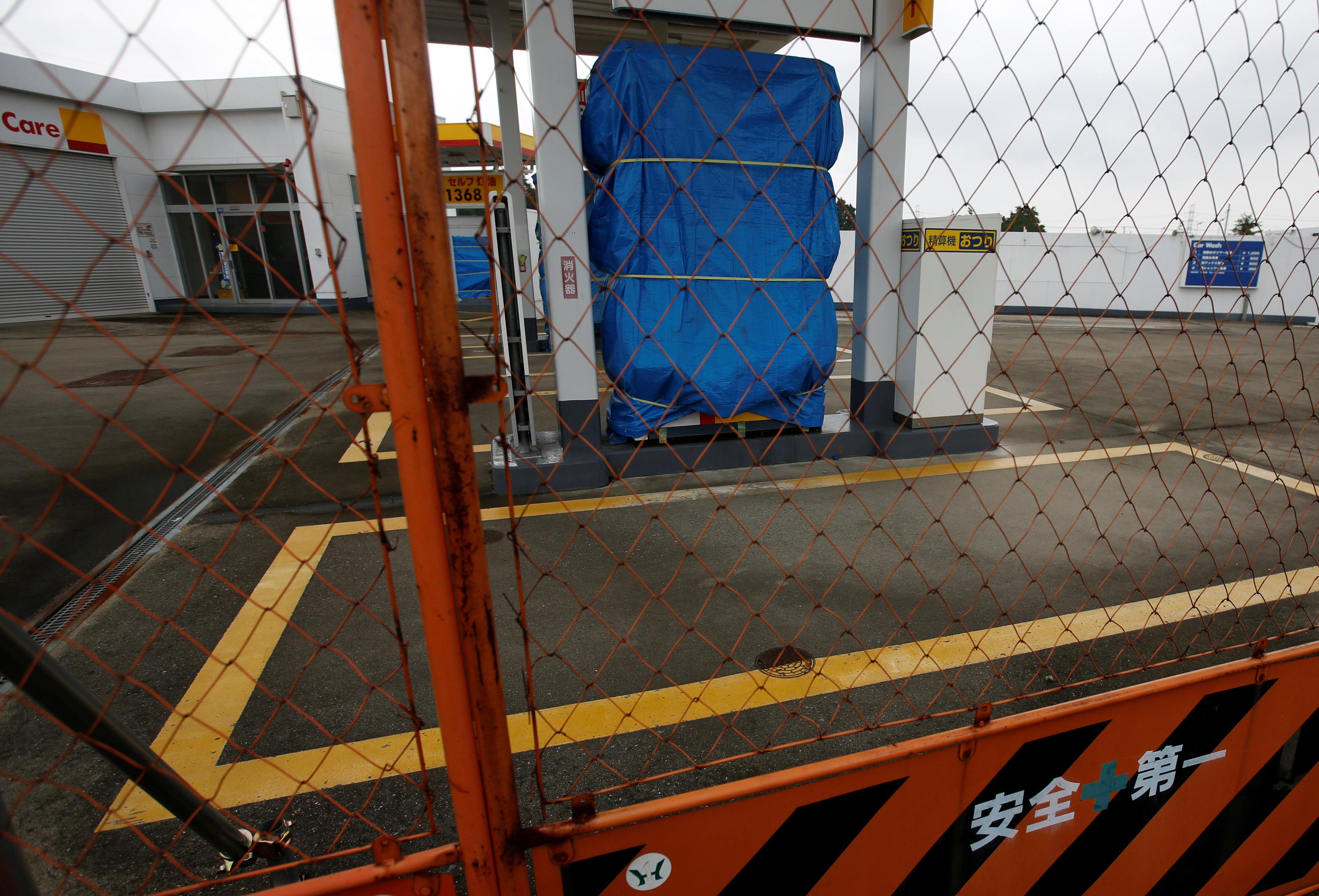 Japan's rural elderly reverse gas station closures