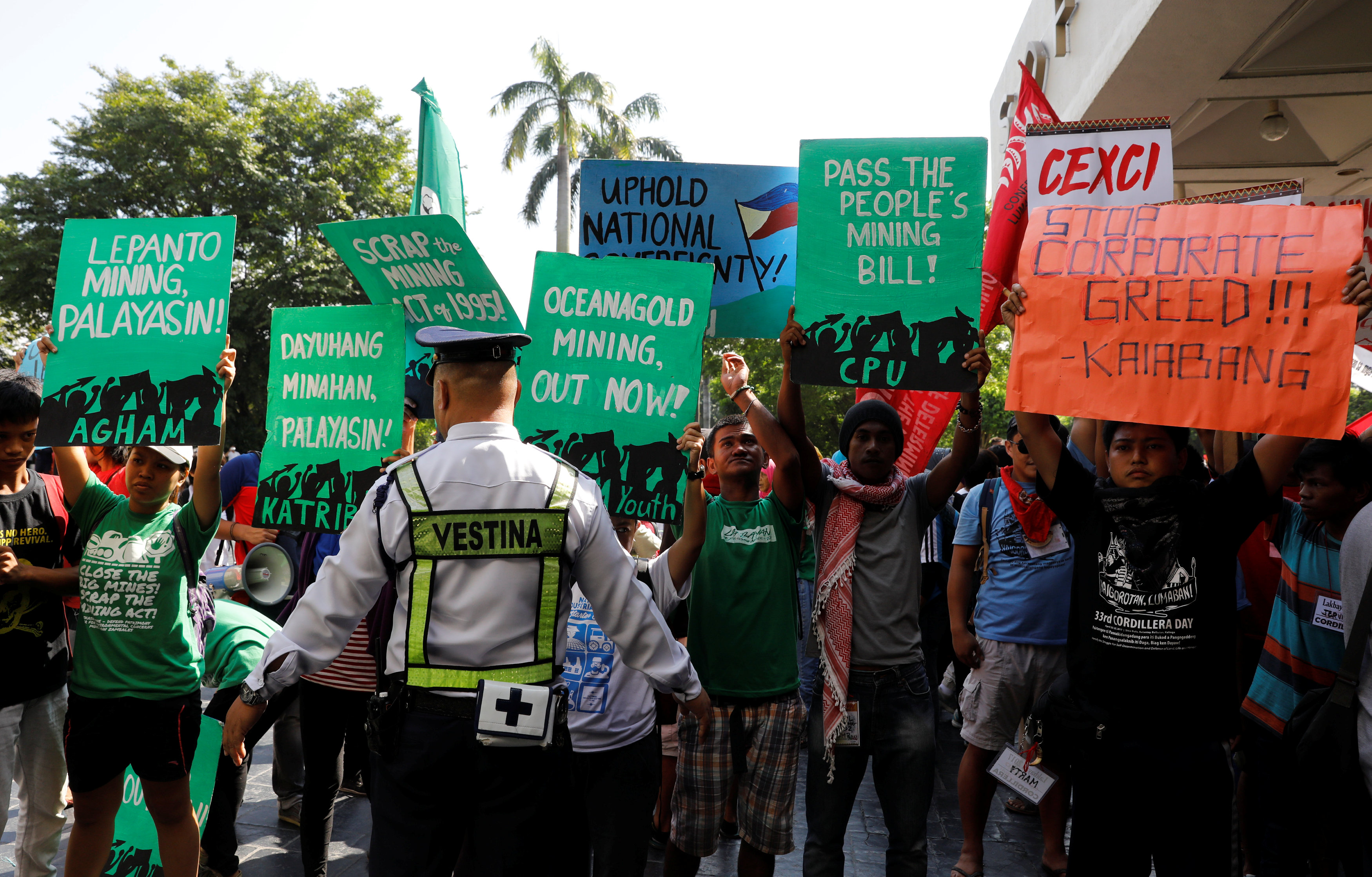 Protesters clash with security forces at Philippines mining event, demand halt to extraction
