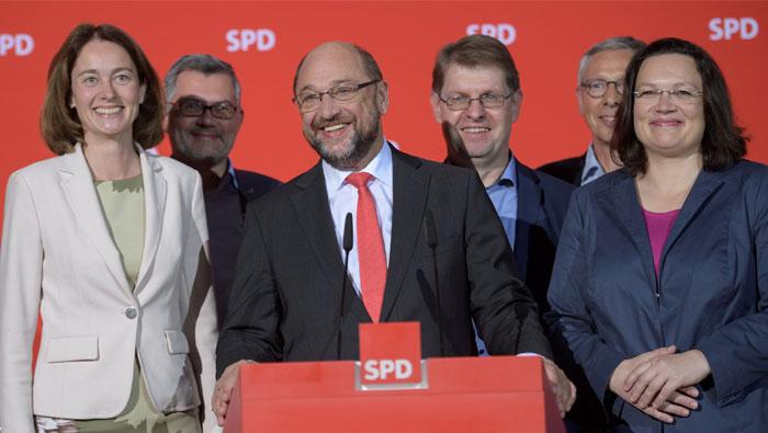 Merkel in state vote setback as national coalition talks loom