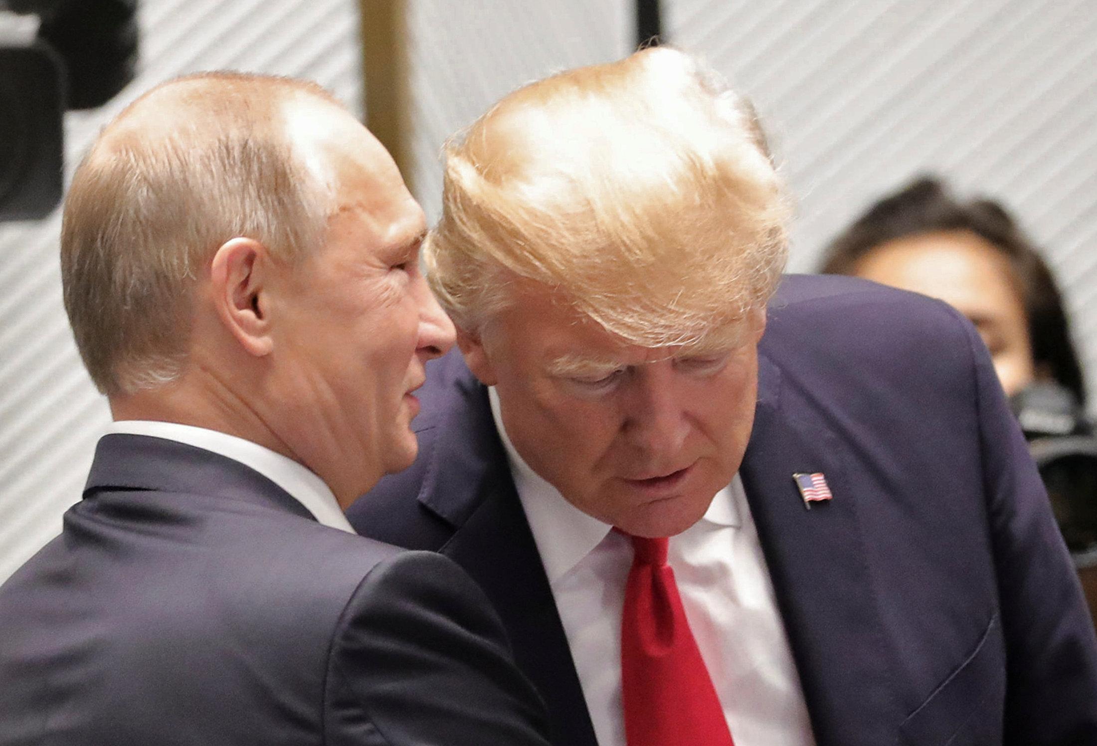 Trump distances himself from remarks on Putin over election meddling
