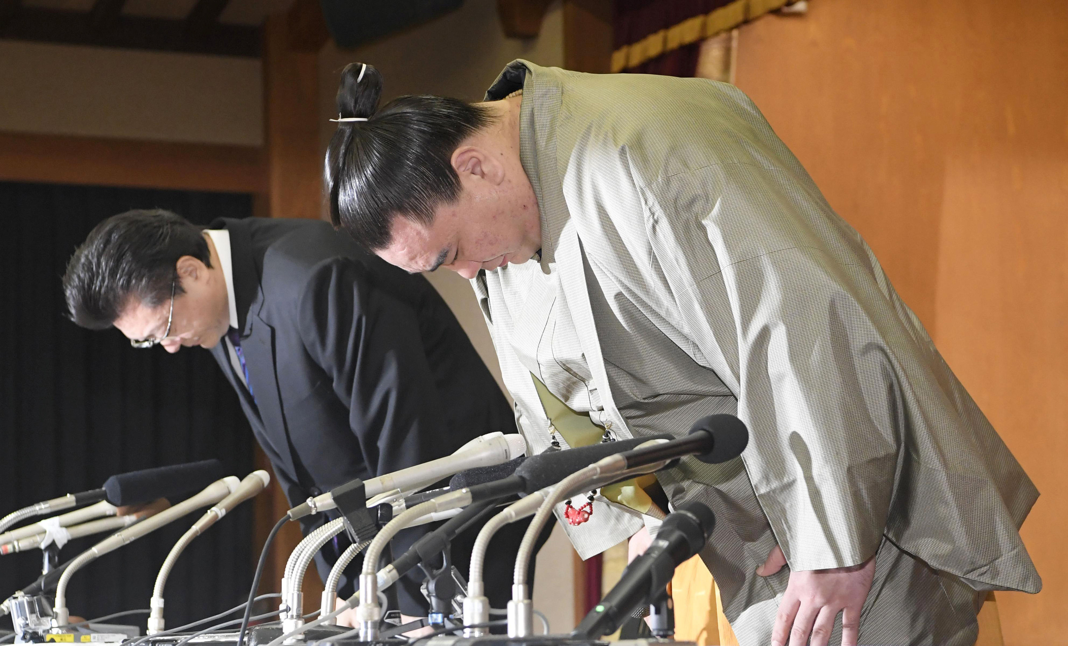 Grand sumo champion retires after brutal attack on rival