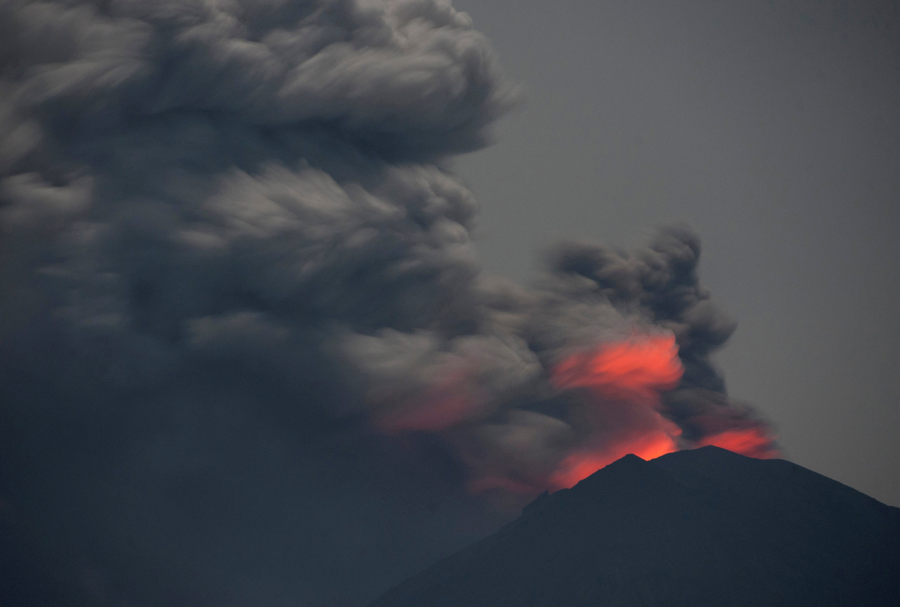 Bali airport shut by volcanic ash reopens