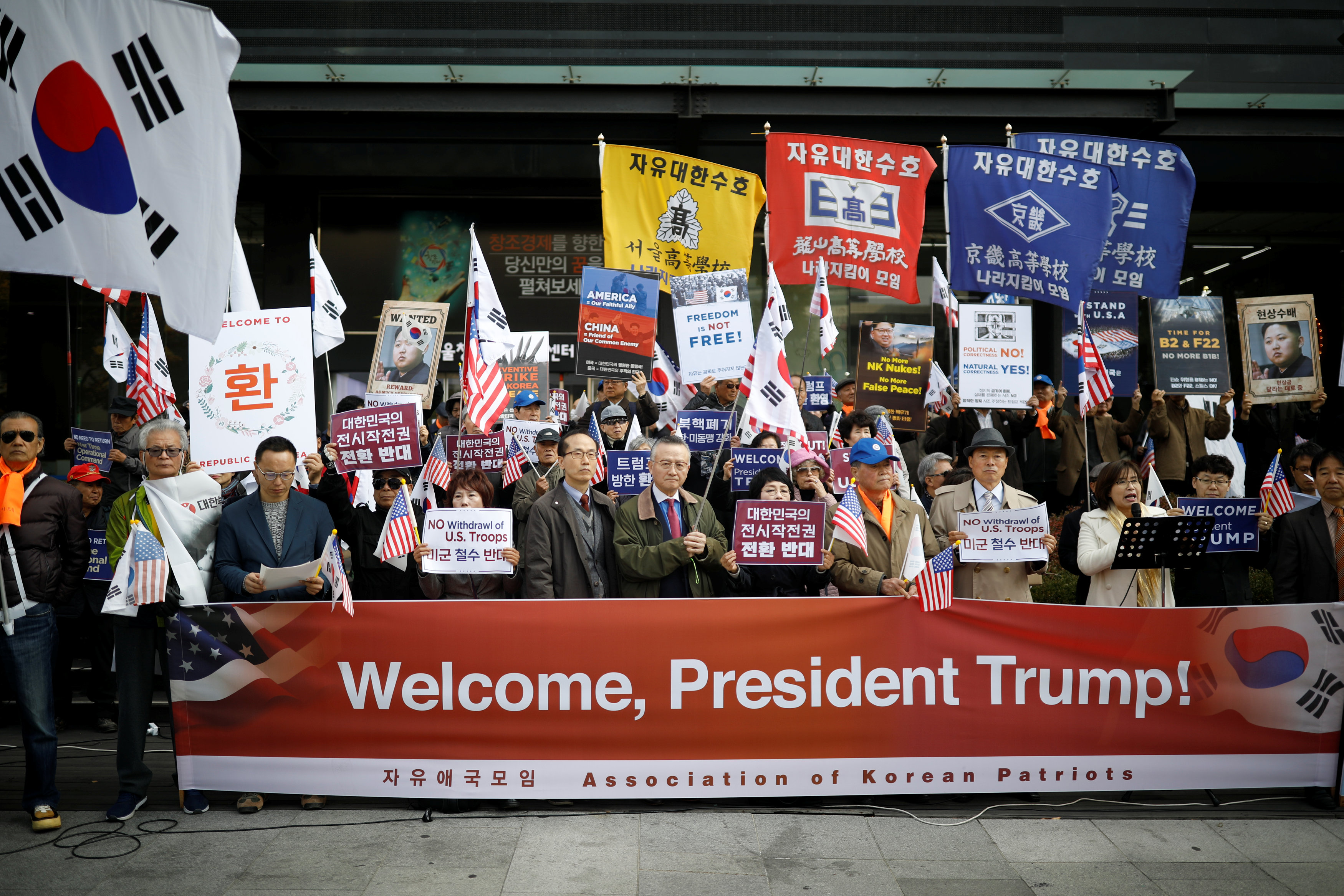 South Korea imposes sanctions on 18 North Koreans a day before Trump visit
