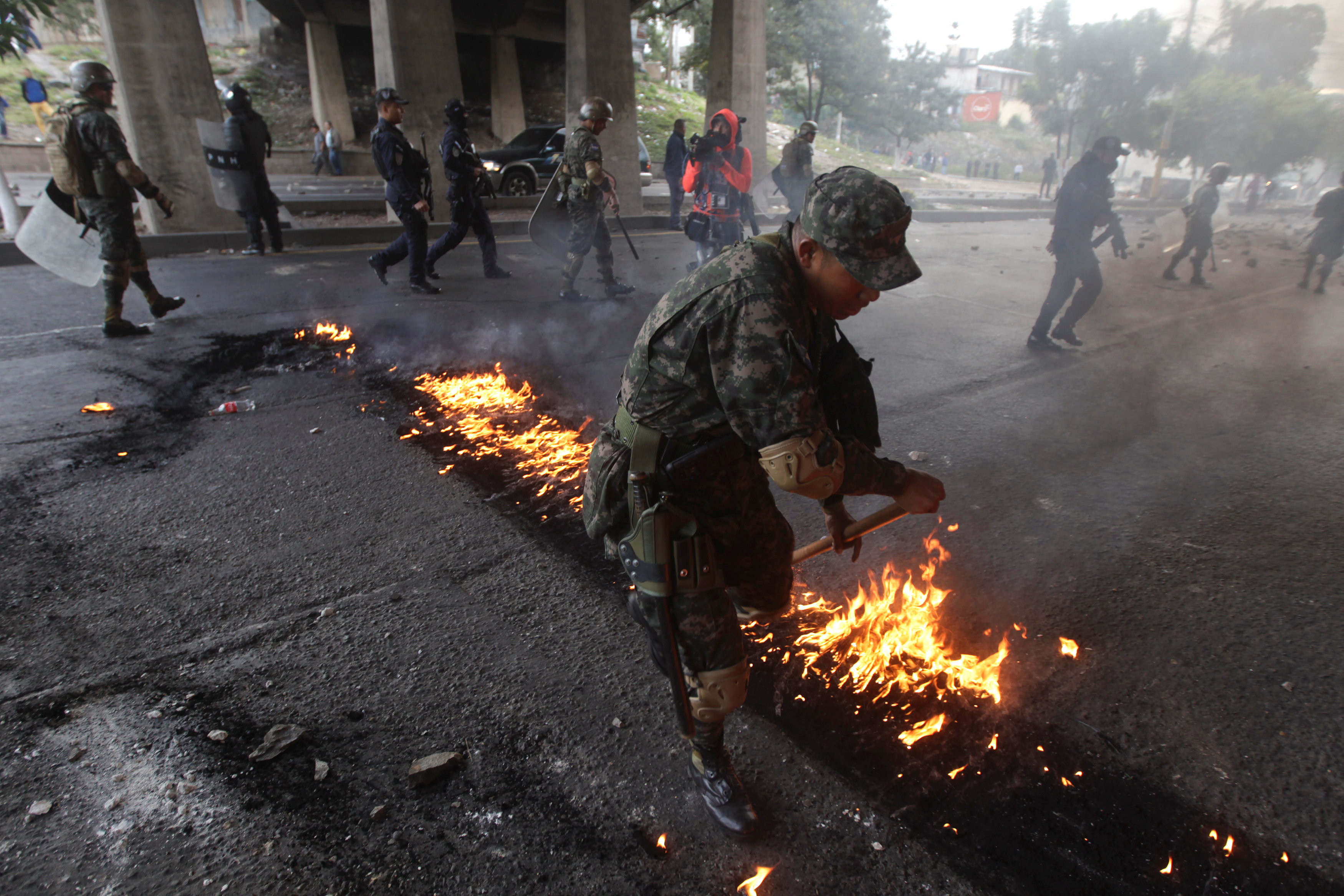Army clears streets of protesters alleging poll fraud in Honduras