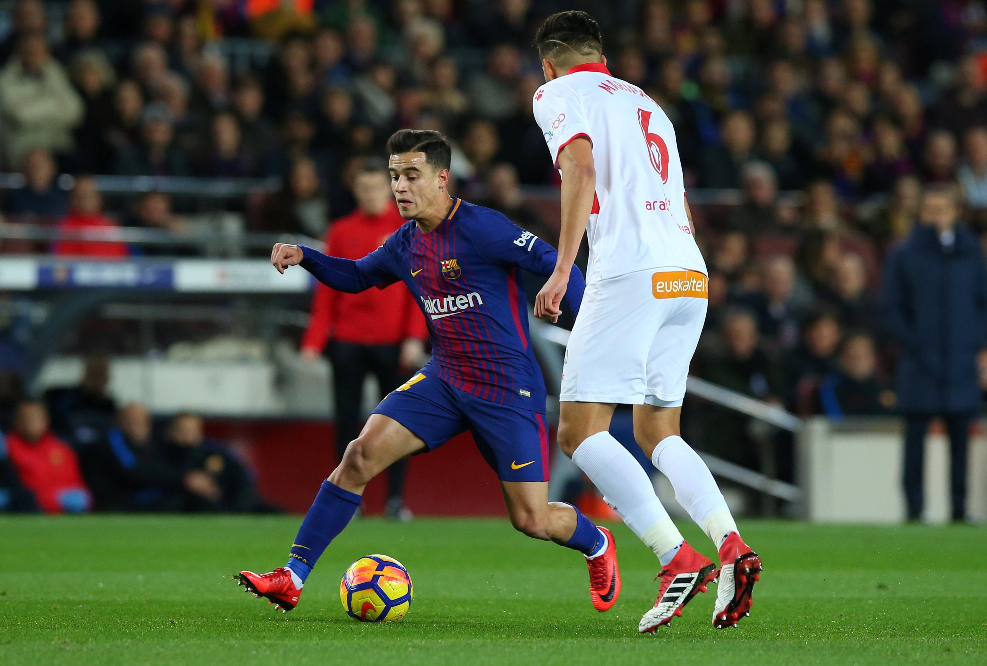 Suarez, Valverde defend Coutinho after quiet debut