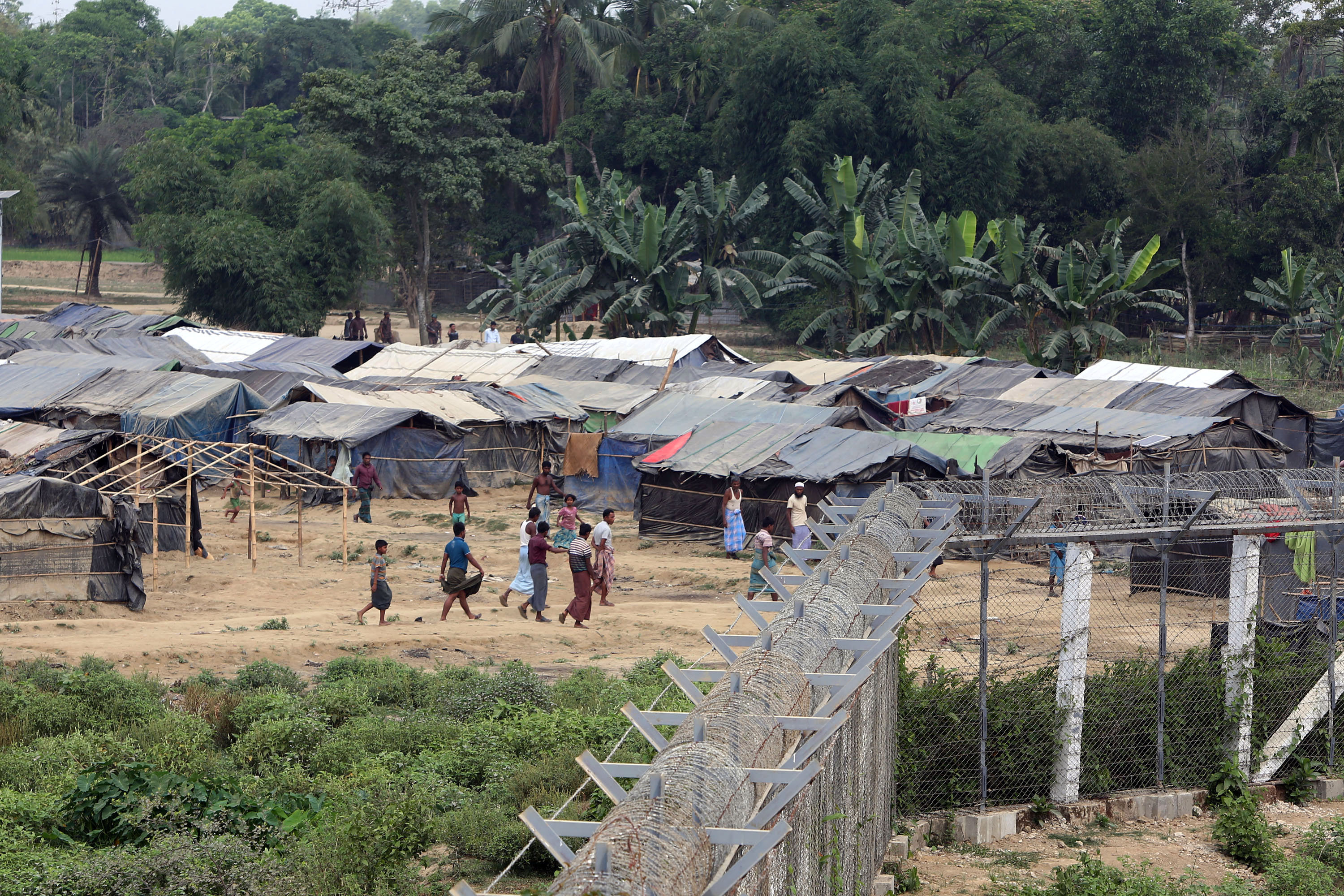 Boat with Rohingya refugees restocks after storm in southern Thailand