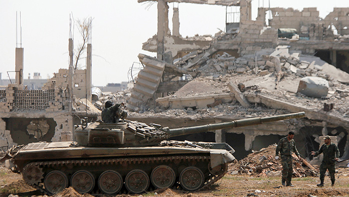 Syrian army says 'enemy' rockets hit military bases