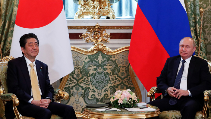 Putin, after meeting Abe, calls for restraint on North Korea
