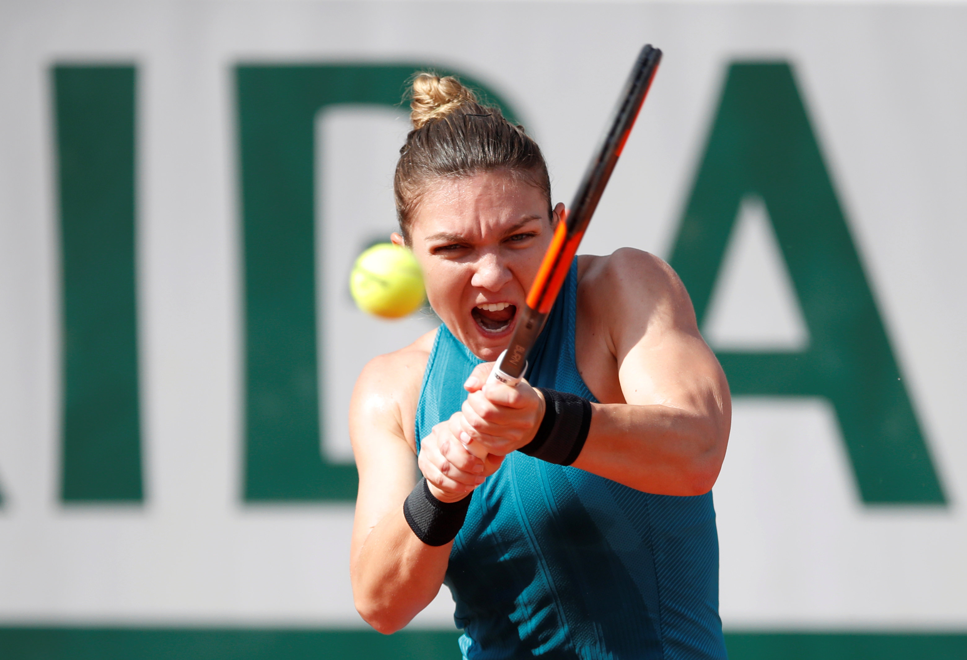 French Open: Halep subdues Petkovic after tight early tussle