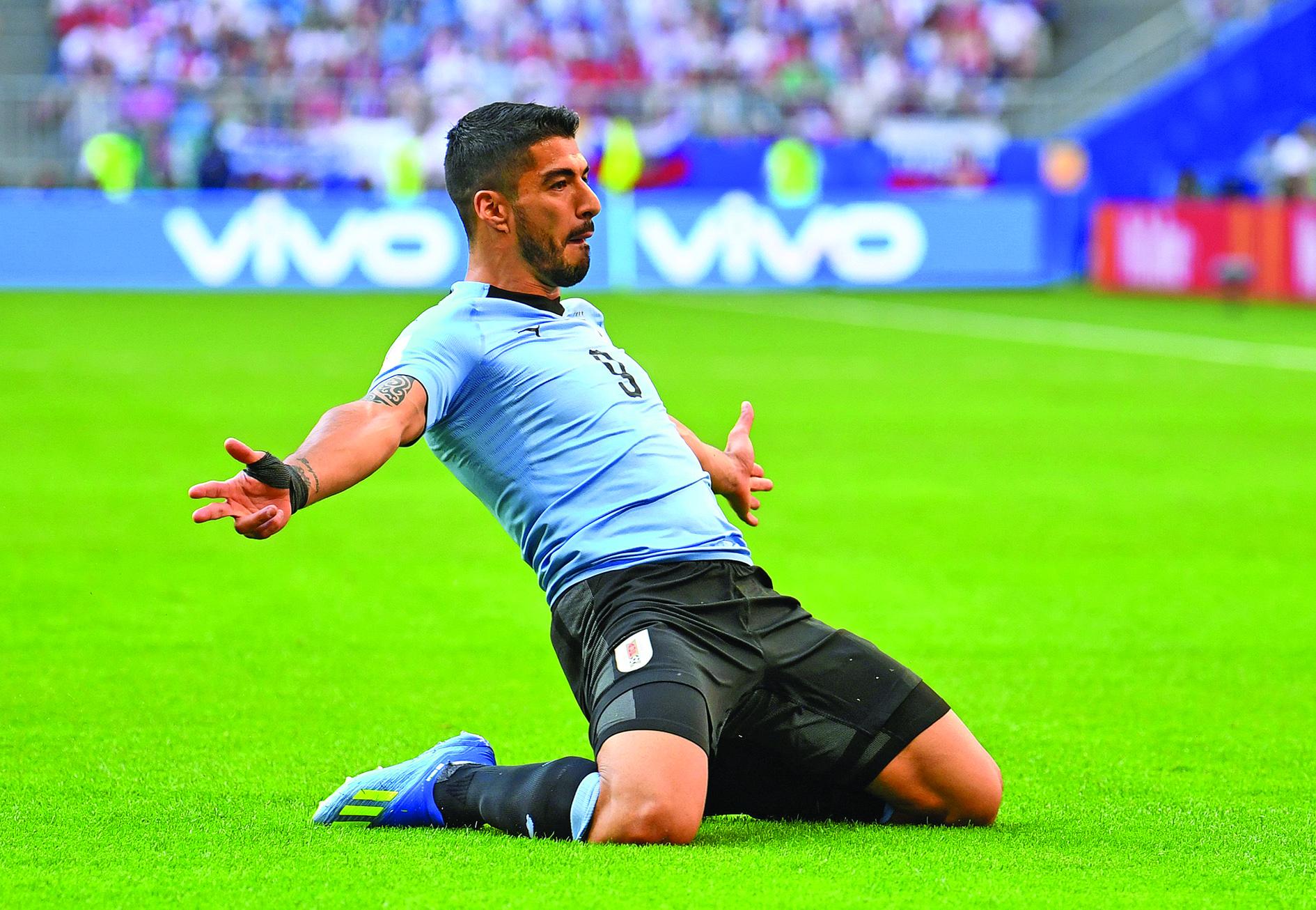 Football: Uruguay punish sluggish Russia to top Group A