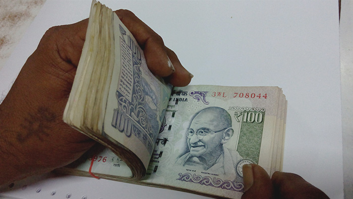 Indian rupee hit hard by oil price rise, trade war