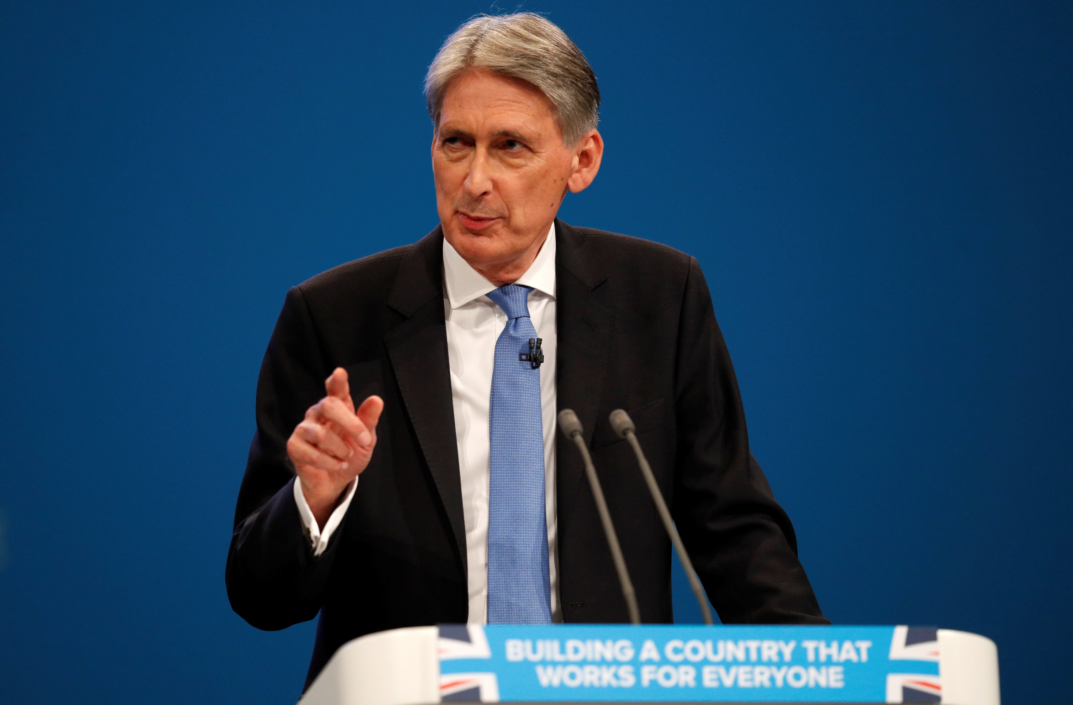 Britain committed to free trade, Hammond tells China