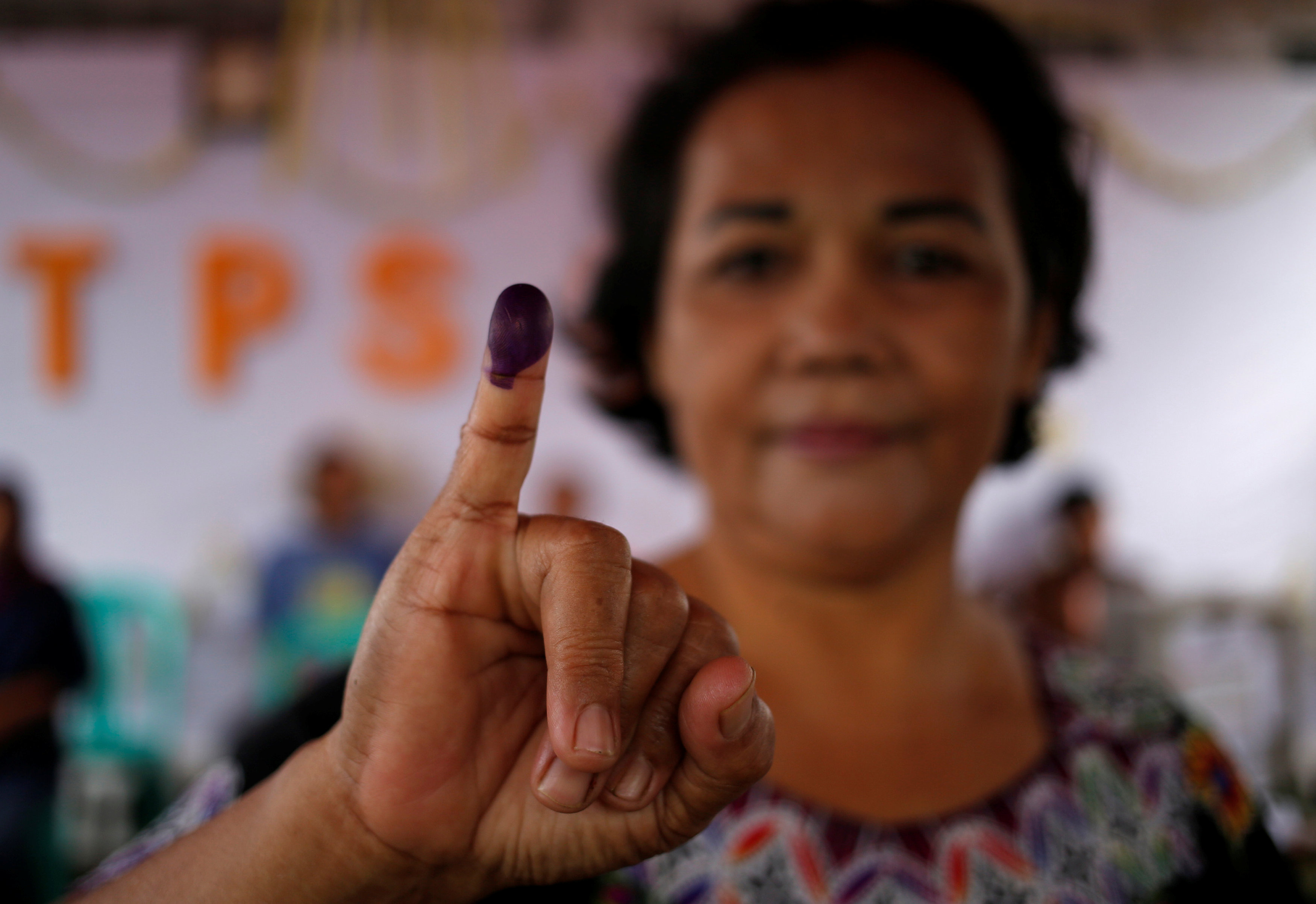 Unofficial counts in Indonesia's regional polls favour Widodo