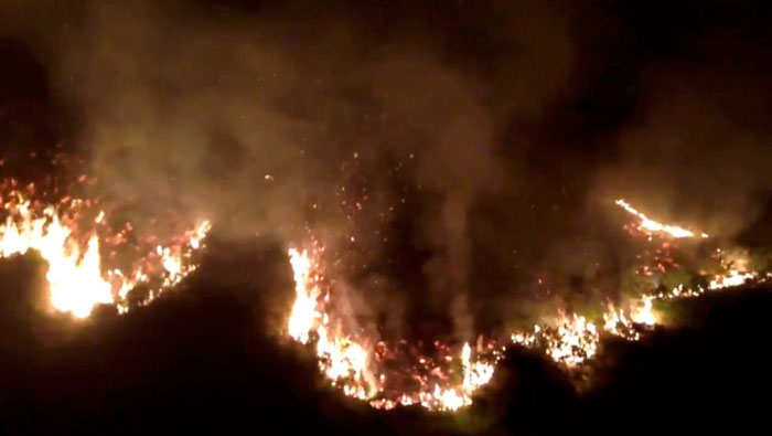 Homes evacuated as British moorland fire rages