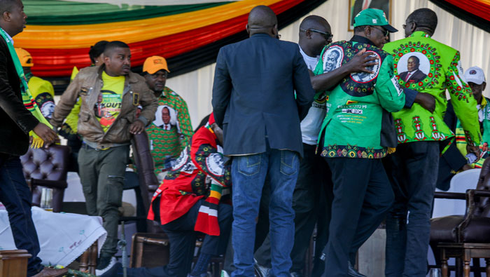 Zimbabwe president suspects political faction behind rally blast