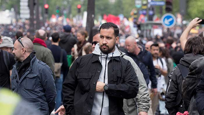 France's Macron under fire after aide hits street protester