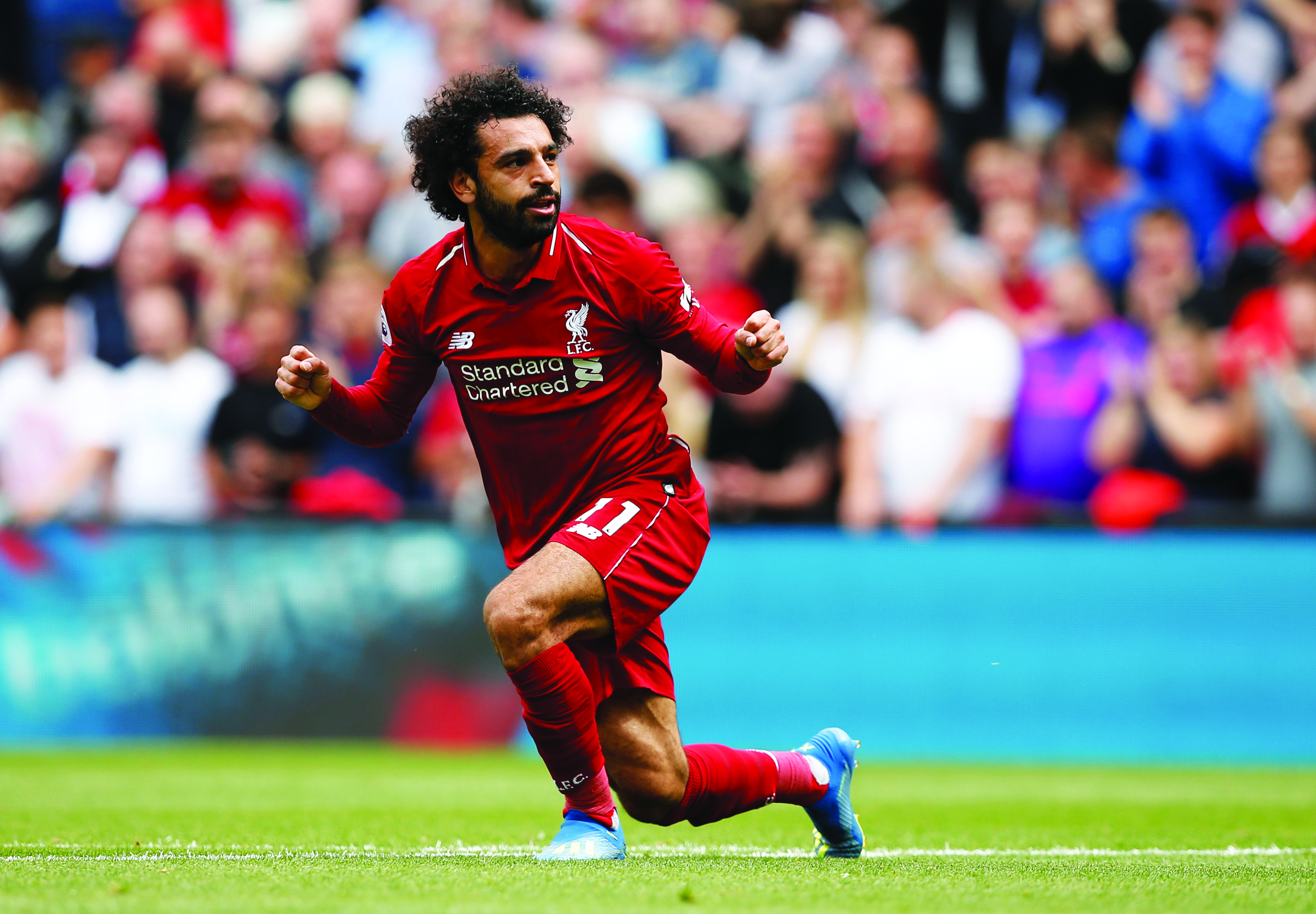 Football: Salah on target as Liverpool start with easy win