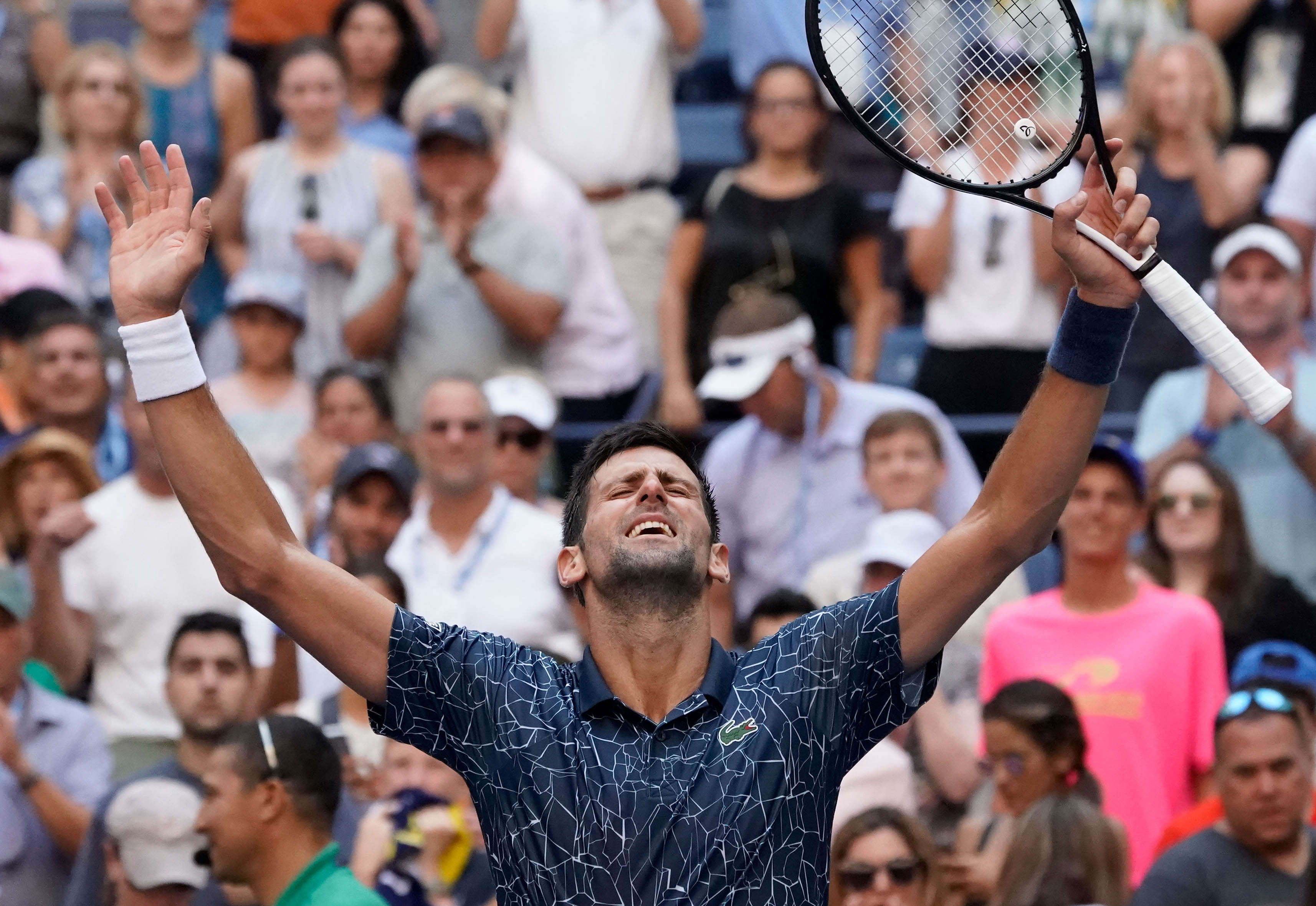Tennis: Djokovic beats heat and Sousa to reach quarters