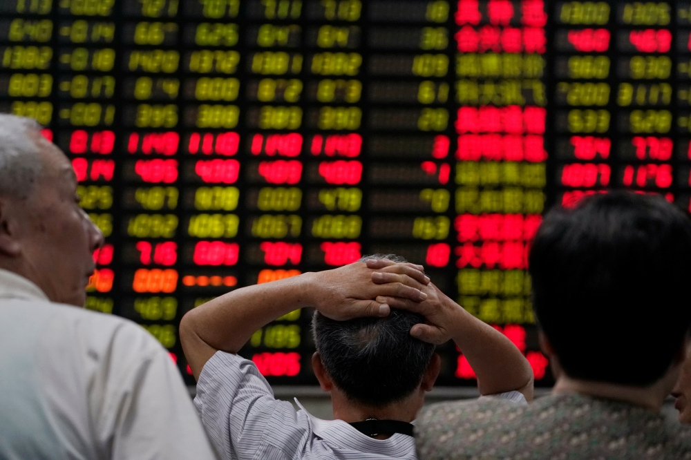 Asia stocks falter as China knocked by renewed trade war fears