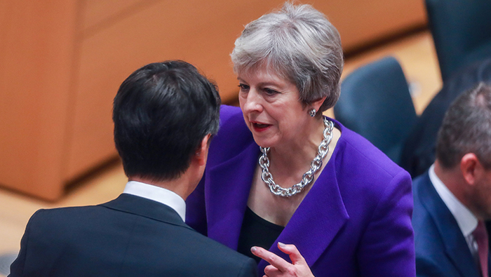 To overcome Brexit impasse, May open to extending transition