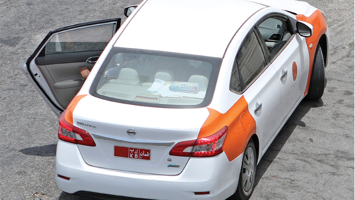 Metered orange and white taxis from next year